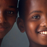 Houmed, 13, left, and Said Abdoul, 11, wait for their skit in a classroom as part of World Environmental Day. Students from five local elementary schools came to Ecole Annexe 1 in Djibouti City for World Environment Day. The children performed skits on environmental awareness and speakers included Elmi Obsieh Waiss, Djiboutian Minister of Environmental Management and City Planning and Sunil Saigal, Resident Coordinator of the United Nations Operational Activities for Development and Resident Representative of United Nations Development Program. <br /> Family and friends of the children were invited to attend. The five schools all have environmental clubs which maintain the trees and gardens on school grounds. The event was attended by Combined Joint Task Force Horn of Africa (CJTF HOA) personnel Netherlands Marine Capt. Hans Steensma and U.S. Navy Capt. Kevin Hutcheson, CJTF HOA Political Advisor. U.S. Navy photo by Photographer's Mate Second Class Roger S. Duncan. (RELEASED)