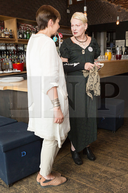 © Licensed to London News Pictures. 02/07/2015. London, UK. VIVIENNE WESTWOOD and CAROLINE LUCAS chat at an artists against Transatlantic Trade and Partnership (TTIP) photocall at the New Vic Theatre in London. The TTIP is a free trade and investment treaty currently being negotiated between the European Union and the USA. Photo credit : Vickie Flores/LNP