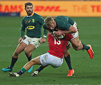 Rugby Union - 2021 British & Irish Lions Tour of South Africa - Second Test: South Africa vs British & Irish Lions<br /> <br /> Pieter Steph du Toit getting tackled by Chris Harris, at Cape Town Stadium, Cape Town.<br /> <br /> COLORSPORT / JOHAN ORTON