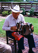 Ophe J. Romero playing accordion and performing traditional Arcadian music, St. Martinville, Louisiana.