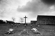 Graves of recently interred monks at Sancta Maria Abbey at Nunraw, East Lothian, home since 1946 to the Order of Cistercians of the Strict Observance. Around 15 monks were resident at Nunraw in 1996, undertaking a mixture of daily tasks and strict religious observance. The present purpose-built building dates from 1969 when the monks moved from the nearby Nunraw house.