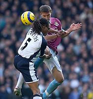 Photo: Daniel Hambury.<br />Tottenham Hotspur v West Ham Utd. The Barclays Premiership. 20/11/2005.<br />Spurs' Edgar Davids and West Ham's Mark Noble compete for the ball.