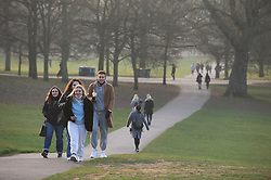 © Licensed to London News Pictures 02/03/2021. Greenwich, UK. People get out of their homes from a third national Coronavirus lockdown to enjoy the sunset in Greenwich Park, London. Photo credit:Grant Falvey/LNP