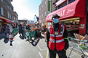 A parking order officer in South London is wearing a face mask while patrolling in East Street Market in South London on Tuesday, May 5, 2020. Whilst a few European countries relax the COVID-19 lockdown, Britain still remains under lockdown without an exit strategy yet. (Photo/Vudi Xhymshiti)