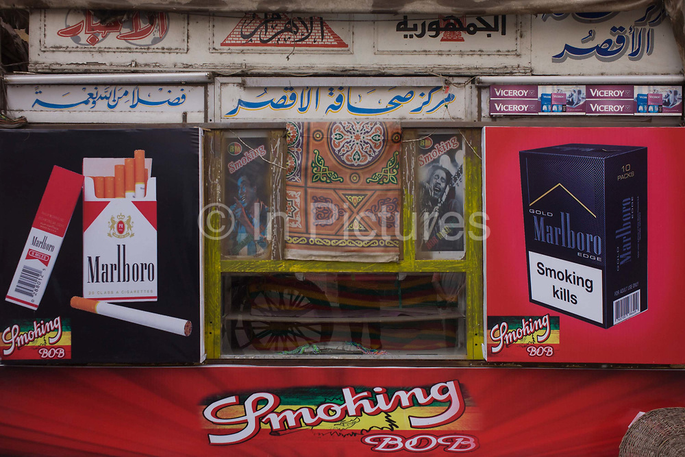 Detail of a poster for Marlboro at a business selling tobacco and smoking paraphernalia in the modern city of Luxor, Nile Valley, Egypt. It is estimated that approximately twenty percent of the population uses tobacco products daily. Cigarettes are the most common form of tobacco consumption in Egypt, with an estimated twenty billion cigarettes smoked annually in the country.