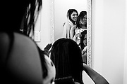 Sasha Martory,Raíca Soares,Lara Santos.The three transsexuals help each other with makeup and hair, just before heading out to the street where they usually work.