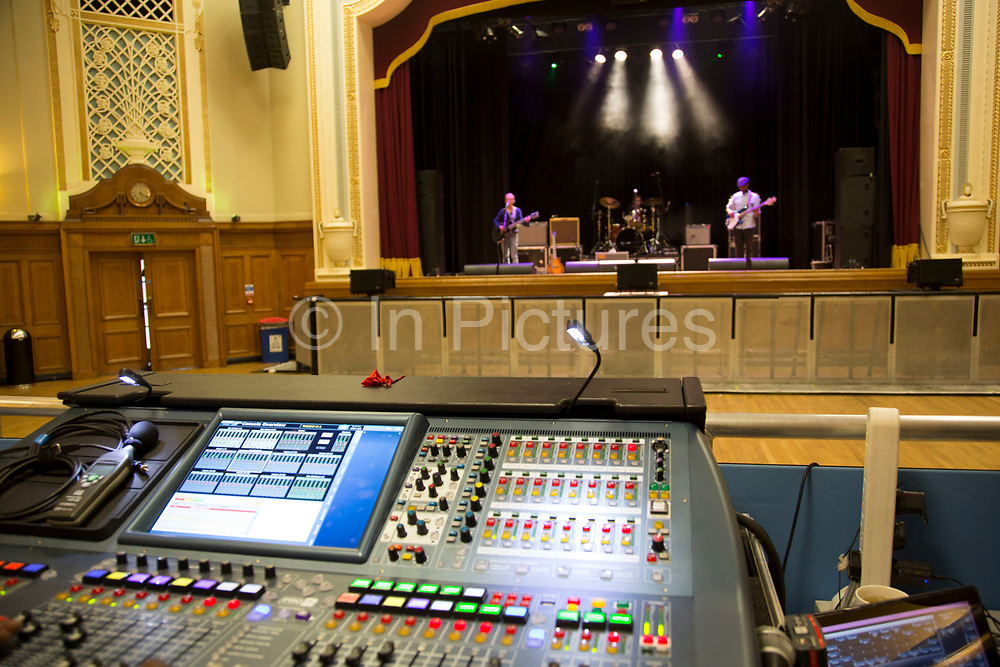 Mixing desk during soundcheck. Throwing Muses at the Islington Assembly Hall, London, UK. Throwing Muses are an alternative rock band founded in 1980. The group was originally fronted by two lead singers, Kristin Hersh, and Tanya Donelly. Known for performing music with shifting tempos, creative chord progressions, unorthodox song structures, and surreal lyrics, the group was set apart from other contemporary acts by Hersh's stark, writing style, David Narcizo's unusual drumming techniques almost totally without cymbals and Bernard Georges' driving baselines.
