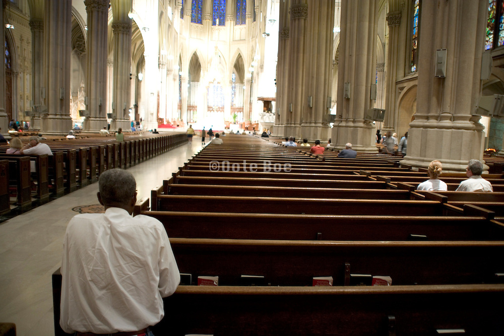 people praying in St Patricks cathedral New York City