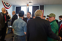 Governor Chris Sununu talks with people in the crowd following the Veteran's Day Ceremony at the New Hampshire Veterans Home on Friday morning.  (Karen Bobotas/for the Laconia Daily Sun)