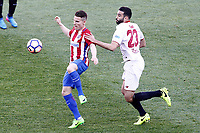 Atletico de Madrid's Kevin Gameiro (l) and Sevilla FC's Adil Rami during La Liga match. March 19,2017. (ALTERPHOTOS/Acero)