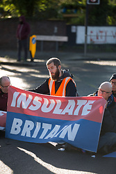 © Licensed to London News Pictures.  04/10/2021. London, UK. Activist from Insulate Britain are seen blocking the A12 Blackwell Tunnel Northern Approach in east London. Photo credit: Marcin Nowak/LNP