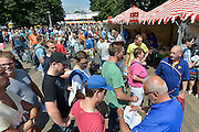 Nederland, Nijmegen, 14-7-2014Inschrijving voor de vierdaagse. Op de Wedren schrijven lopers zich in voor de tocht die dinsdag begint.30, 40 en 50 km. 46.000 deelnemers hebben zich aangemeld. Ze krijgen een polsbandje met een barcode die de controle op het parcours makkelijker maakt.The International Four Day Marches Nijmegen (or Vierdaagse) is the largest marching event in the world. It is organized every year in Nijmegen mid-July as a means of promoting sport and exercise. Participants walk 30, 40 or 50 kilometers daily, and on completion, receive a royally approved medal, Vierdaagsekruisje. The participants are mostly civilians, but there are also a few thousand military participants. The maximum number of 45,000 registrations has been reached. More than a hundred countries have been represented in the Marches over the years. FOTO: FLIP FRANSSEN/ HOLLANDSE HOOGTE