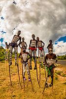 Bena tribe boys walking on stilts near Key Afer, Omo Valley, Ethiopia.