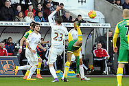 Swansea's Gylfi Sigurdsson (23) clashes with Norwich's Gary O'Neil. Barclays Premier league match, Swansea city v Norwich city at the Liberty Stadium in Swansea, South Wales on Saturday 5th March 2016.<br /> pic by  Carl Robertson, Andrew Orchard sports photography.