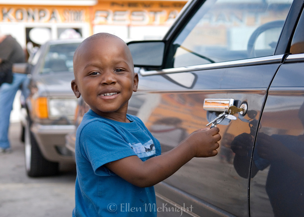 Haitian Boy Playing with Keys in Florida