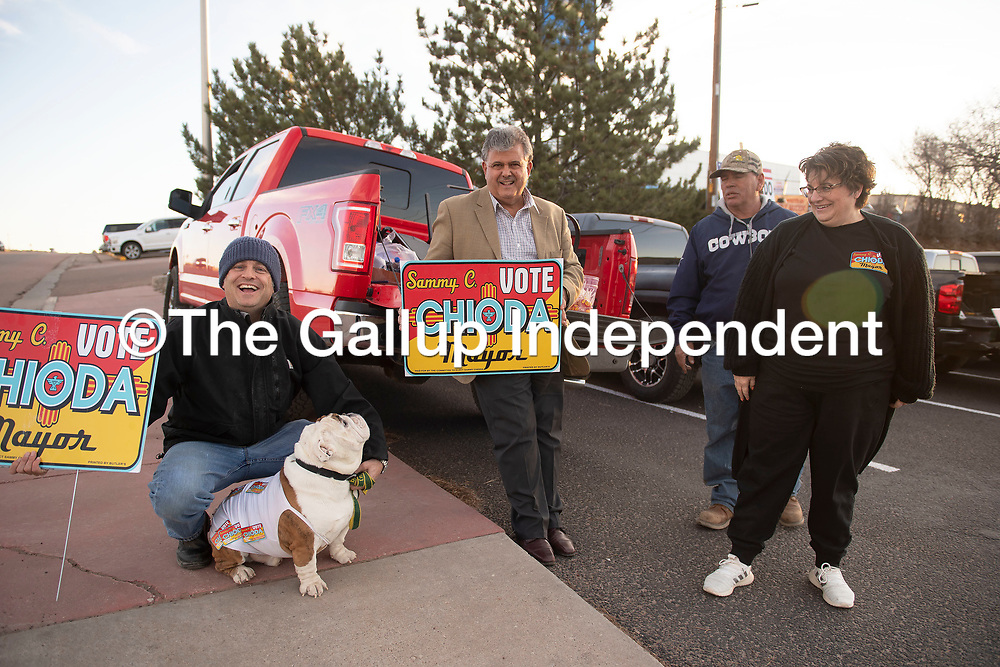 Mayoral candidate Sammy Chioda, center, campaigns outside the Southside Fire Station No. 1 as voters cast their ballots for the City of Gallup 2020 Municipal Officer Election Tuesday, March 3 in Gallup.