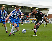Photo: Andrew Unwin.<br />Hartlepool Utd v Swansea. Coca Cola League 1.<br />17/09/2005.<br />Swansea's Lee Trundle (R) can't find a way through the Hartlepool defence.