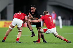 Shannon Frizell - New Zealand flanker powers through the tackles of Ross Moriarty and James Davies (R).<br /> New Zealand v Wales, Rugby World Cup, Bronze Final, Tokyo Stadium, Tokyo, Japan, Saturday 1st November 2019. ***Please credit: Fotosport/David Gibson***