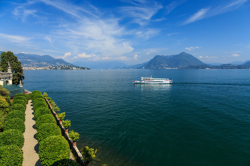 A boat at Lago Di Maggiore, Italy. Visitors to Lake Maggiore will find that the boat is by far the best way to enjoy the marvelous scenery in a slow, more relaxing way.  The story of the Navigazione boat service began already in 1826.