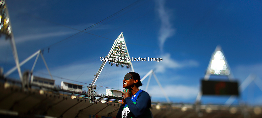 A picture taken with a tilt and shift lens shows Izabela Campos of Brazil competing in the women's Shot Put F11/12 final at the Olympic Stadium during the London 2012 Paralympic Games in London, Britain, 05 September 2012.  EPA/KERIM OKTEN