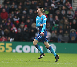 10 December 2017 Southampton : Premier League Football : Southampton v Arsenal : Arsenal captain Per Mertesacker removes his captain armband as he sprints off the pitch to be substituted.<br /> (photo by Mark Leech)