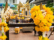 22 AUGUST 2015 - BANGKOK, THAILAND: Flower garland offerings left on the fence around Erawan Shrine. Erawan Shrine in Bangkok reopened Wednesday, August 19, after more than 20 people were killed and more than 100 injured in a bombing at the shrine Monday, August 17, 2015. The shrine is a popular tourist attraction in the center of Bangkok's high end shopping district and is an important religious site for Thais. No one has claimed responsibility for the bombing.             PHOTO BY JACK KURTZ
