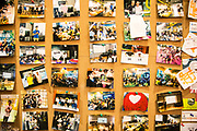 Photos posted on a bulletin board inside a You+ community in Beijing, China, on Monday, Nov. 30, 2015. Nearly 5,000 people across China have moved into co-living spaces called You+, a name meant to inspire young people to infinitely expand their horizons. About 60 startups call the Beijing location home — developing mobile games, services that improve sleep patterns and much more.