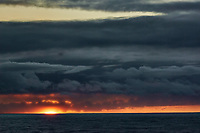 Angry electric clouds at sunrise over the Pacific Ocean from the deck of the MV World Odyssey. Traveling west from Hawaii to Japan. Semester at Sea, Spring 2016 voyage -- Day 11. Nikon 1 V3 camera and 70-300 mm lens (ISO 200, 70 mm, f/11, 1/60 sec).