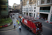 Biffa bin lorry collecting refuse on the streets of Barbican in London, England, United Kingdom.