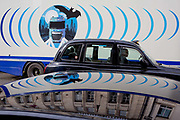 The design on the side of an HGV for the rehearsal studio company Fly By Nite and a passing taxi cab in Great Marlborough Street, on 5th March 2019, in London, England.