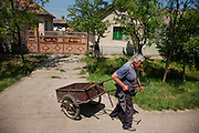 A neighbor of the Mladic family in Lazarevo, Serbia, who declined to be identified, leaves the compound where he had been assisting with work...Matt Lutton for The International Herald Tribune..Capture of Ratko Mladic. Lazarevo, Serbia. May 27, 2011.