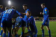 AFC Wimbledon Jack Rudoni (12) celebrating after AFC Wimbledon midfielder Callum Reilly (33) scoring goal during the EFL Sky Bet League 1 match between AFC Wimbledon and Doncaster Rovers at the Cherry Red Records Stadium, Kingston, England on 14 December 2019.