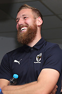 AFC Wimbledon midfielder Scott Wagstaff (7) laughing during the EFL Sky Bet League 1 match between AFC Wimbledon and Oxford United at the Cherry Red Records Stadium, Kingston, England on 29 September 2018.