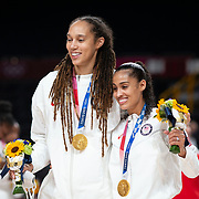 TOKYO, JAPAN August 8:  Brittney Griner #15 of the United States and Skylar Diggins-Smith #5 of the United States with their gold medals after the Japan V USA basketball final for women at the Saitama Super Arena during the Tokyo 2020 Summer Olympic Games on August 8, 2021 in Tokyo, Japan. (Photo by Tim Clayton/Corbis via Getty Images)