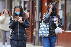 © Licensed to London News Pictures. 01/03/2020. London, UK. Asian women wearing surgical face masks in Chinatown as a precaution against new type coronavirus (COVID-19). Twelve more people have tested positive for coronavirus in the UK, bringing the total number of cases to 35. Photo credit: Dinendra Haria/LNP