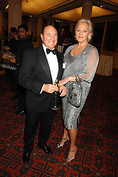MR ARNOLD CROOK of the Theatre Royal Haymarket  and his wife JEANNE MANDRY at a Gala dinner in aid of Chickenshed held at the Guildhall, City of London on 29th October 2007.<br />