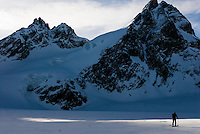 A skier traverses the Mont Collon Glacier on the final day of the Haute Route traverse in Switzerland.
