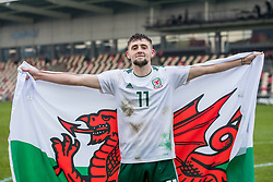 NEWPORT, WALES - Tuesday, November 19, 2019: Wales' Joseph Adams celebrates a 2-0 victory over Kosovo after the UEFA Under-19 Championship Qualifying Group 5 match between Kosovo and Wales at Rodney Parade. (Pic by Paul Greenwood/Propaganda)