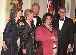 Elizabeth Taylor poses for a photo with United States President Bill Clinton and his family at the White House dinner on 31 December, 1999. (L-R) Chelsea Clinton, First Lady Hillary Rodham Clinton, U.S. President Bill Clinton, Elizabeth Taylor, and Firooz Zahedi. Photo by Ron Sachs/CNP/ABACAPRESS.COM