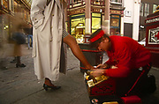 A 1990s businesswoman in the City of London, the capitals financial district, puts one shoe for a shoeshine in Leadenhall Market, on 15th April 1993, City of London, England.