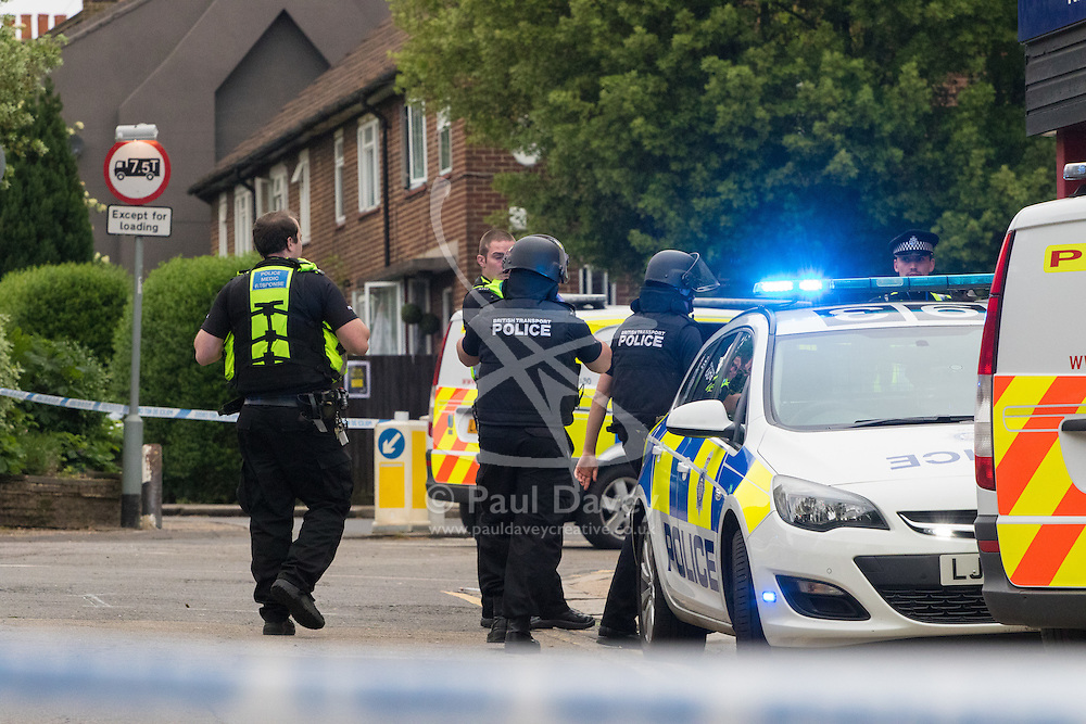 """Kensal Green, London, May 31st 2016. Police in body armoured protective headgear seal off Kensal Green tube station in North West London in what is described as a """"security incident""""."""