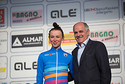 Katarzyna Niewiadoma (Rabo-Liv Cycling Team) and Renato di Rocco, member of the UCI Management Comittee stand on the podium, after the Trofeo Alfredo Binda - a 123.3km road race from Gavirate to Cittiglio on March 20, 2016 in Varese, Italy.