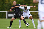 Hawke's Bay United's Bill Robertson and Auckland City FC's Dré Vollenhoven tussle for the ball in the Handa Premiership football match, Hawke's Bay United v Auckland City FC, Bluewater Stadium, Napier, Sunday, January 31, 2021. Copyright photo: Kerry Marshall / www.photosport.nz