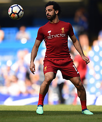 Liverpool's Mohamed Salah warms up ahead of the match
