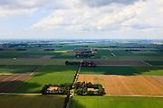 Nederland, Noordoostpolder, 30-06-2011; Johannes Postweg (doorsneden door de A6). De Noordoostpolder (NOP), is een voorbeeld van moderne grootschalige polder met rationele verkaveling. De aanleg van de polder maakte  deel uit van de Zuiderzeewerken (plan Lely) en viel in 1942 droog. De meeste boerderijen (en dorpen) zijn van na de tweede wereldoorlog..The northeast polder (NOP), is an example of modern large-scale polder with rational allotment. The construction of the polder was part of the Zuiderzee Works (Lely plan), in 1942 the polder was dry. Most of the building, farmhouses and villages, is post-war..luchtfoto (toeslag), aerial photo (additional fee required).copyright foto/photo Siebe Swart