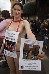 """Self proclaimed """"crazy vegan"""" Heidi Mary Porter proteststs semi-naked outside London's up-market Harrods department store, which still sells fur trade products. Many furs are taken from animals using extremely cruel methods while the animals are still alive."""