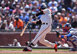 April 29, 2018 - San Francisco, CA, U.S. - SAN FRANCISCO, CA - APRIL 29: San Francisco Giants Catcher Buster Posey (28) connects for a double in the first inning of the  San Francisco Giants and Los Angeles Dodgers game at AT&T Park on April 29, 2018 in San Francisco, CA.  (Photo by Stephen Hopson/Icon Sportswire) (Credit Image: © Stephen Hopson/Icon SMI via ZUMA Press)
