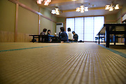 interior of a traditional japanese restaurant dining room with Tatami floor