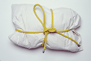 pillow with a yellow rope B237tied around