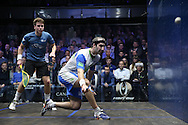Simon Rosner of Germany (in the white shirt) with a shot against Charles Sharpes of England (in the Green shirt).Canary Wharf Squash Classic 2016 , day two at the East Wintergarden in Canary Wharf , London on Tuesday 8th March 2016.<br /> pic by John Patrick Fletcher, Andrew Orchard sports photography.